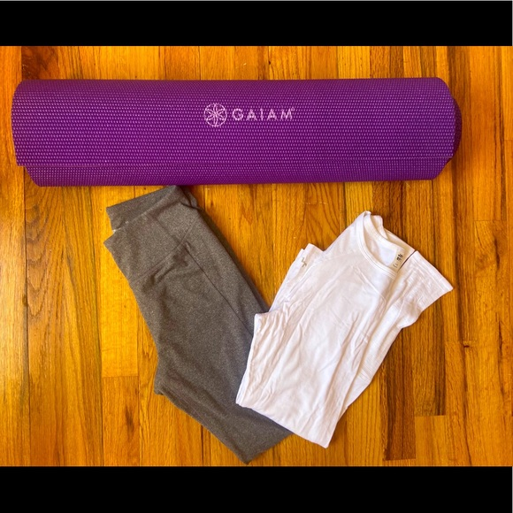 Yoga mat with workout clothing.